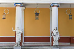 Achilleion palace, Corfu, Greece. Ancient Greek statues standing outside a classic era temple Royalty Free Stock Photo