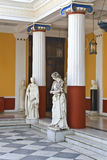 Achilleion palace, Corfu, Greece. Ancient Greek statues standing outside a classic era temple Stock Image