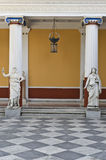 Achilleion palace, Corfu, Greece. Ancient Greek statues standing outside a classic era temple Royalty Free Stock Photos