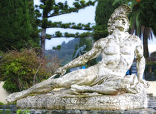 Achilles Dying. Statue of Achilles dying, shot in the foot with an arrow.  Located in the gardens of the  Achillion Palace, Corfu, Greece Stock Photography