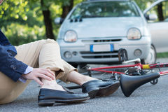 Aching man after bicycle accident Stock Images