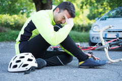 Aching man after bicycle accident Royalty Free Stock Image