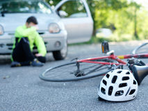 Aching man after bicycle accident Royalty Free Stock Photography