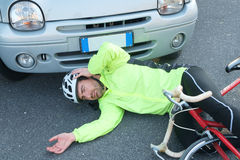 Aching man after bicycle accident Royalty Free Stock Photos