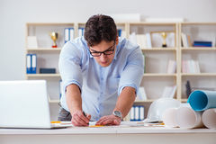 The achitect working on blueprint drawings. Achitect working on blueprint drawings Royalty Free Stock Photos