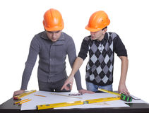 Achitects standing over blueprints Royalty Free Stock Photography