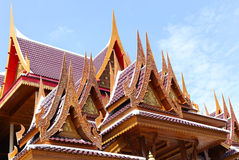 Achitecture building of ancient wooden roof temple in Thailand. With fine wooden carving stock photo