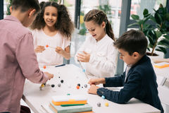 Achoolchildren studying with molecular model at chemistry lesson Royalty Free Stock Photos