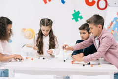 Achoolchildren studying with molecular model at chemistry lesson Stock Photos