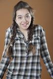 Achselzucken des jungen Mädchens Lizenzfreie Stockfotografie