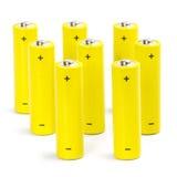 Acht gelbe alkalische Batterien Stockfotos