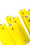 Acht gelbe alkalische Batterien Stockfotografie