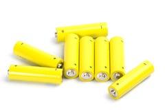 Acht gelbe alkalische Batterien Lizenzfreie Stockfotos