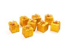Acht goldene Geschenkkästen Lizenzfreies Stockbild