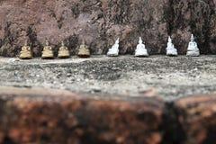 Acht kleiner Plastik-Buddha Lizenzfreie Stockfotografie