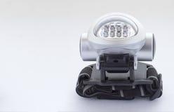 Acht LED kopf-angebrachte Taschenlampe mit einem Band Stockfoto