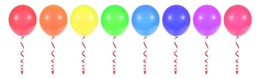 Mehrfarbige Ballone gebunden mit rotem Band Stockbild
