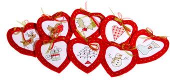 Acht rote Herzen mit unterschiedlicher Stickerei Lizenzfreie Stockfotografie