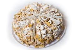 Acht Stück des Kuchens in pulverisiertem Zucker mit Sahne. Lizenzfreie Stockfotos