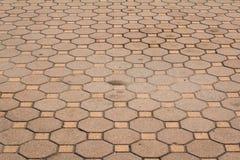 Achteckiger Ziegelstein und Quadrathintergrund und -beschaffenheit Stockbild
