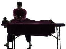 Achter massagetherapie Stock Afbeeldingen