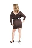 Achter mening van meisje in bruine kleding royalty-vrije stock afbeeldingen