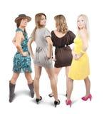 Achter mening van vier meisjes Stock Foto