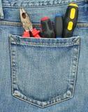 Achter zak van jeans met hulpmiddelen Stock Afbeeldingen