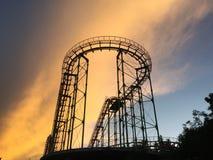 Achterbahn bei Sonnenuntergang Stockbilder