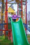 Achterbahn des kleinen Mädchens Reit Stockbilder