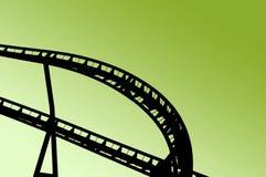 Achterbahnform auf Spaßmesse Stockfotografie