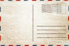Achtereind van lege prentbriefkaar met vuile vlek stock foto's