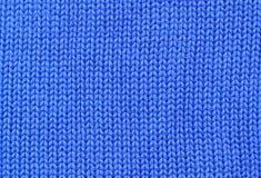 Achtergrond - close-up van blauwe gebreide textiel Stock Foto's