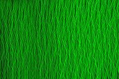 Achtergrond met groen laserlicht dat wordt gecreeerd Stock Afbeeldingen