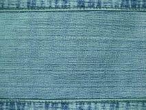 Achtergrond een materiaal van jeans van donkerblauwe kleur Stock Afbeeldingen