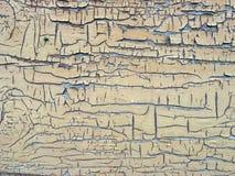 Achtergrond - een muur in een oude verf stock afbeeldingen