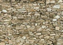 Achtergrond - een muur van natuursteen wordt gemaakt dat Stock Afbeelding