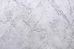 Achtergrond en textuur van decoratief pleister om de muren en de plafonds te behandelen achtergrond voor ontwerp en decoratie royalty-vrije stock afbeeldingen