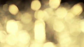 Achtergrond glanzende lichte gouden brandsamenvatting bokeh stock footage