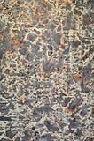 Achtergrond in grijze, en gekenmerkte textuur Stock Foto