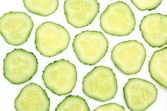 Achtergrond met komkommerplakken Royalty-vrije Stock Afbeeldingen