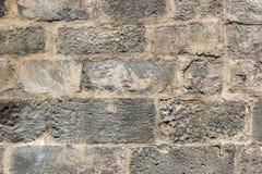 Achtergrond met muur van de darkgrey de uitstekende steen Stock Afbeelding