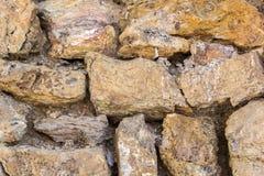 Achtergrond met uitstekende stenenmuur Stock Foto's