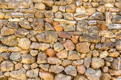 Achtergrond met uitstekende stenenmuur Stock Fotografie