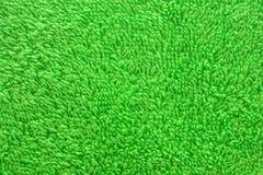 Achtergrond in reliëf gemaakte textuur groene doek Stock Afbeeldingen