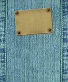 Achtergrond - textuurjeans met etiket Stock Foto