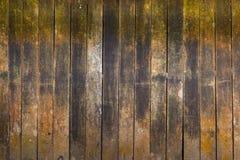 Achtergrond van bederfhout op de oude oppervlakte van de plattelandshuisjemuur Stock Afbeeldingen