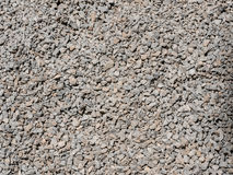 Achtergrond van close-upfoto wordt gemaakt van verpletterde steen die Stock Afbeelding