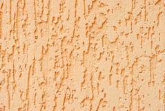 Achtergrond van de de kleurenmuur van de pleister de donkere perzik Stock Foto