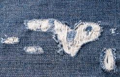 Achtergrond van de gescheurde jeans Stock Foto's